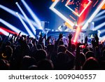 dj party at nightclub. crowd... | Shutterstock . vector #1009040557