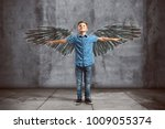 child spreads its wings | Shutterstock . vector #1009055374