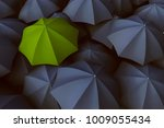green umbrella in between a lot ... | Shutterstock . vector #1009055434