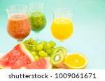 tropical smoothie cocktail with ... | Shutterstock . vector #1009061671