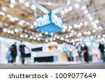 Small photo of trade show booth, generic background with a blur effect applied