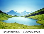 schreckhorn and wetterhorn from ... | Shutterstock . vector #1009095925