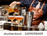 barman in a blue shirt and... | Shutterstock . vector #1009098409
