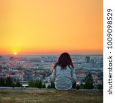 Small photo of Woman sitting and resting above morning city. Leisure, rest photo.