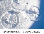 A Bike Print On The Snow