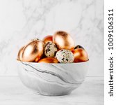 bowl with painted copper eggs... | Shutterstock . vector #1009106311