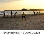 silhouettes of boys playing... | Shutterstock . vector #1009106335
