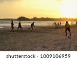 silhouettes of boys playing... | Shutterstock . vector #1009106959