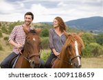 couple riding horses | Shutterstock . vector #1009118659