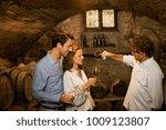 people tasting wine in cellar | Shutterstock . vector #1009123807