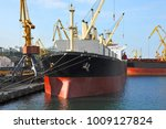 bulk cargo ship under port... | Shutterstock . vector #1009127824