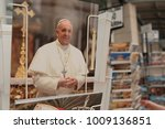 Small photo of Rome, Italy - August 12, 2017: Postcards representing Pope Francis, current Pope of the Catholic Church, a title he holds ex officio as Bishop of Rome, and sovereign of Vatican City