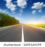asphalt car road and clouds on... | Shutterstock . vector #1009164199