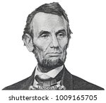 Small photo of President Abraham Abe Lincoln face portrait on 5 dollar bill isolated, five usd, US money closeup