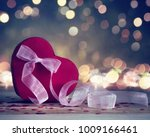 the red heart shapes gift box... | Shutterstock . vector #1009166461