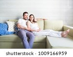 pregnant woman and young man... | Shutterstock . vector #1009166959