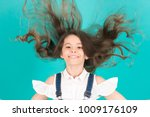 girl smile with flying hair on... | Shutterstock . vector #1009176109