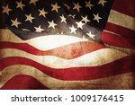 closeup of grunge american flag | Shutterstock . vector #1009176415