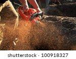 Sawdust Flies As A Man Cuts A...