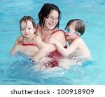 happy family swimming in a pool. | Shutterstock . vector #100918909