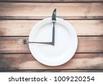 fork with knife and plate on... | Shutterstock . vector #1009220254