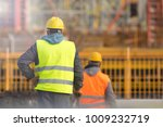 two builders in yellow and... | Shutterstock . vector #1009232719