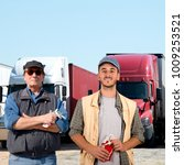 father and son truck drivers | Shutterstock . vector #1009253521