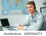 young male travel agent... | Shutterstock . vector #1009266271