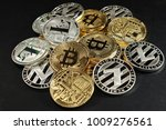 Small photo of Heaf of physical golden bitcoins and silver litecoins