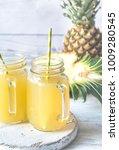 two glasses of pineapple juice   Shutterstock . vector #1009280545