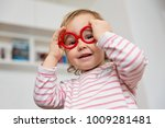 toddler girl playing with... | Shutterstock . vector #1009281481
