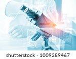 double exposure of microscope... | Shutterstock . vector #1009289467
