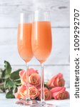 two glasses of bellini cocktail ... | Shutterstock . vector #1009292707
