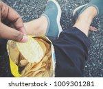 selfie of hand with potato chips | Shutterstock . vector #1009301281