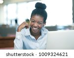 laughing young black female...   Shutterstock . vector #1009324621