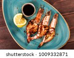 roasted langoustine with sauce... | Shutterstock . vector #1009332871