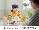 asian family having breakfast... | Shutterstock . vector #1009336945