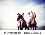 young tourist couple horseback... | Shutterstock . vector #1009365271