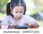 cute asian little child girl... | Shutterstock . vector #1009371331