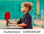 the boy with the racket for... | Shutterstock . vector #1009385269