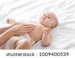 woman applying body cream on...   Shutterstock . vector #1009400539