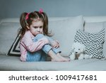 sad or angry little girl ... | Shutterstock . vector #1009417681