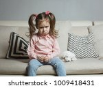sad or angry little girl ... | Shutterstock . vector #1009418431