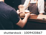 woman barista giving coffee cup ... | Shutterstock . vector #1009420867