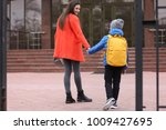 cute little boy going to school ... | Shutterstock . vector #1009427695