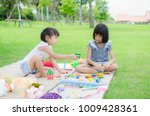 asian child happy play in park | Shutterstock . vector #1009428361
