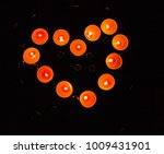 heart made of candles on a... | Shutterstock . vector #1009431901