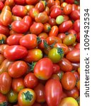 red cherry tomatoes in market... | Shutterstock . vector #1009432534