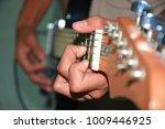 human hand is playing guitar. | Shutterstock . vector #1009446925