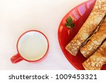 milk in cup and plate of... | Shutterstock . vector #1009453321
